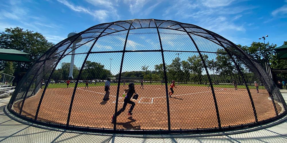 Children playing softball at Ackerman Park
